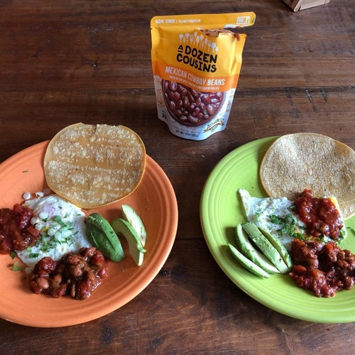reviewer's bag of pinto beans and some on a plate with avocado, tortillas, and cheese