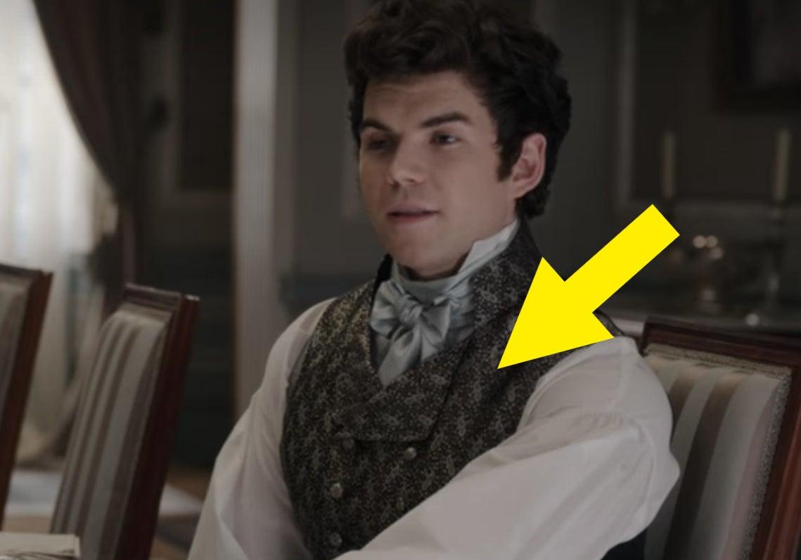 An arrow pointing at his waistcoat