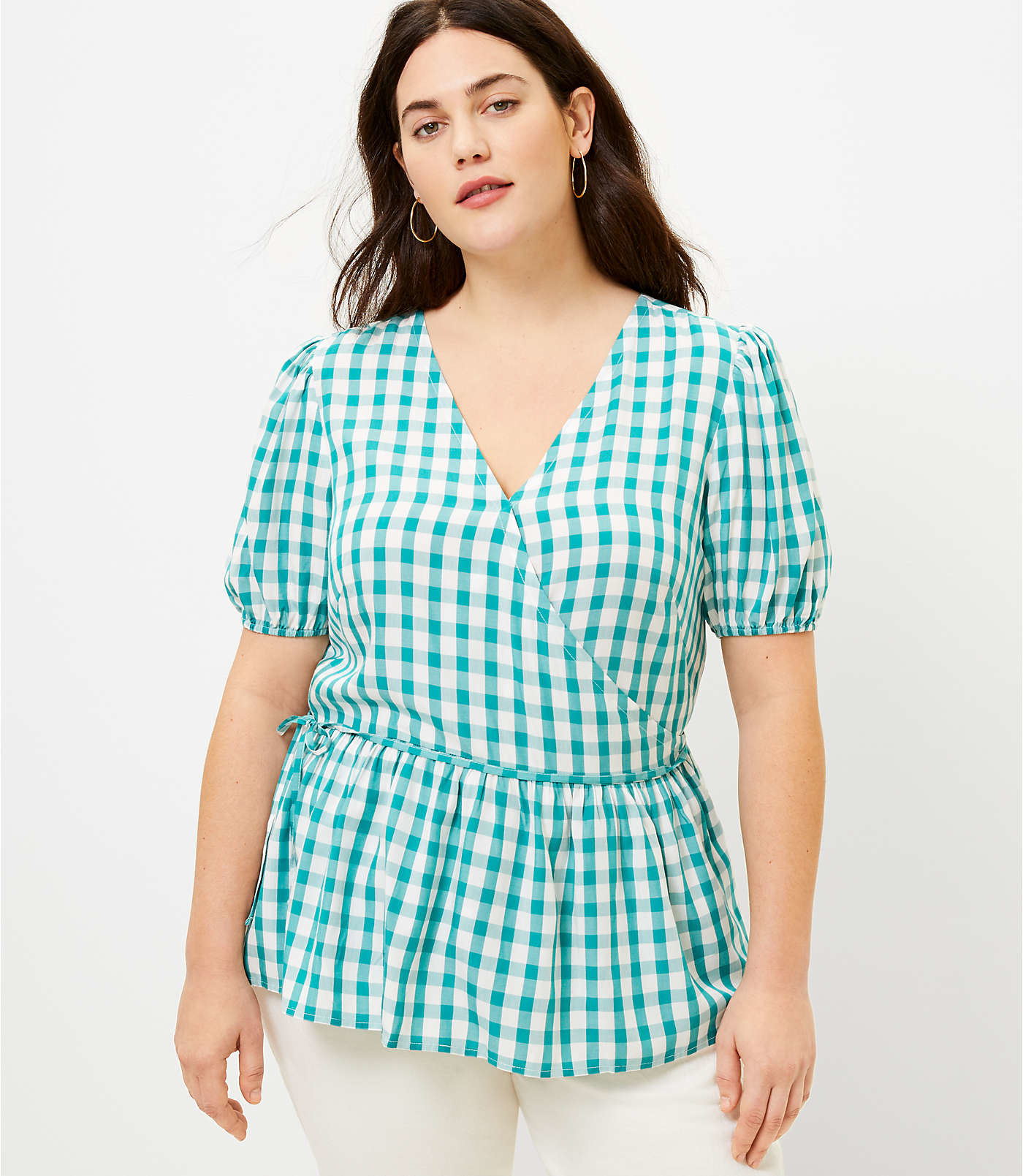model wearing the blue and white gingham top