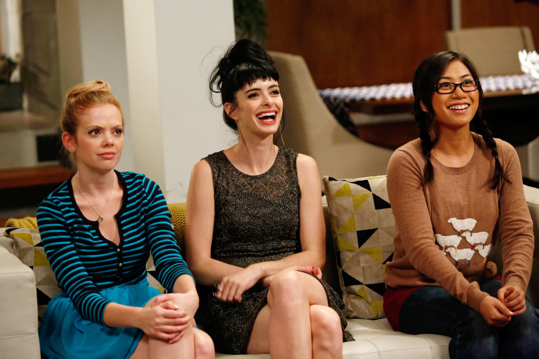 three women watching someone speak
