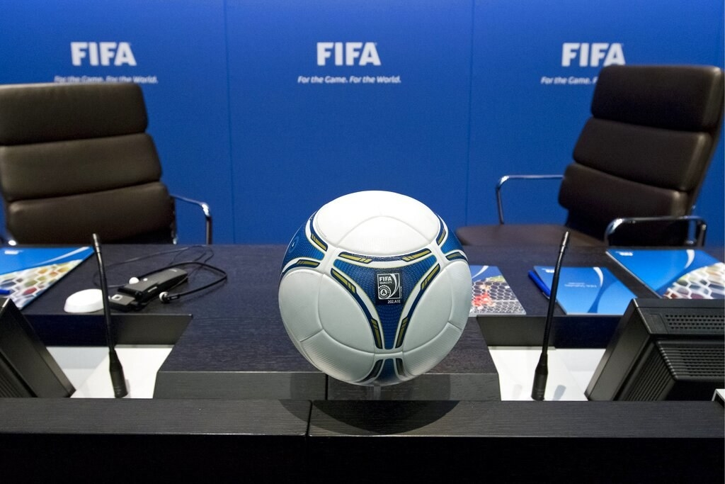 An empty desk at a FIFA conference table
