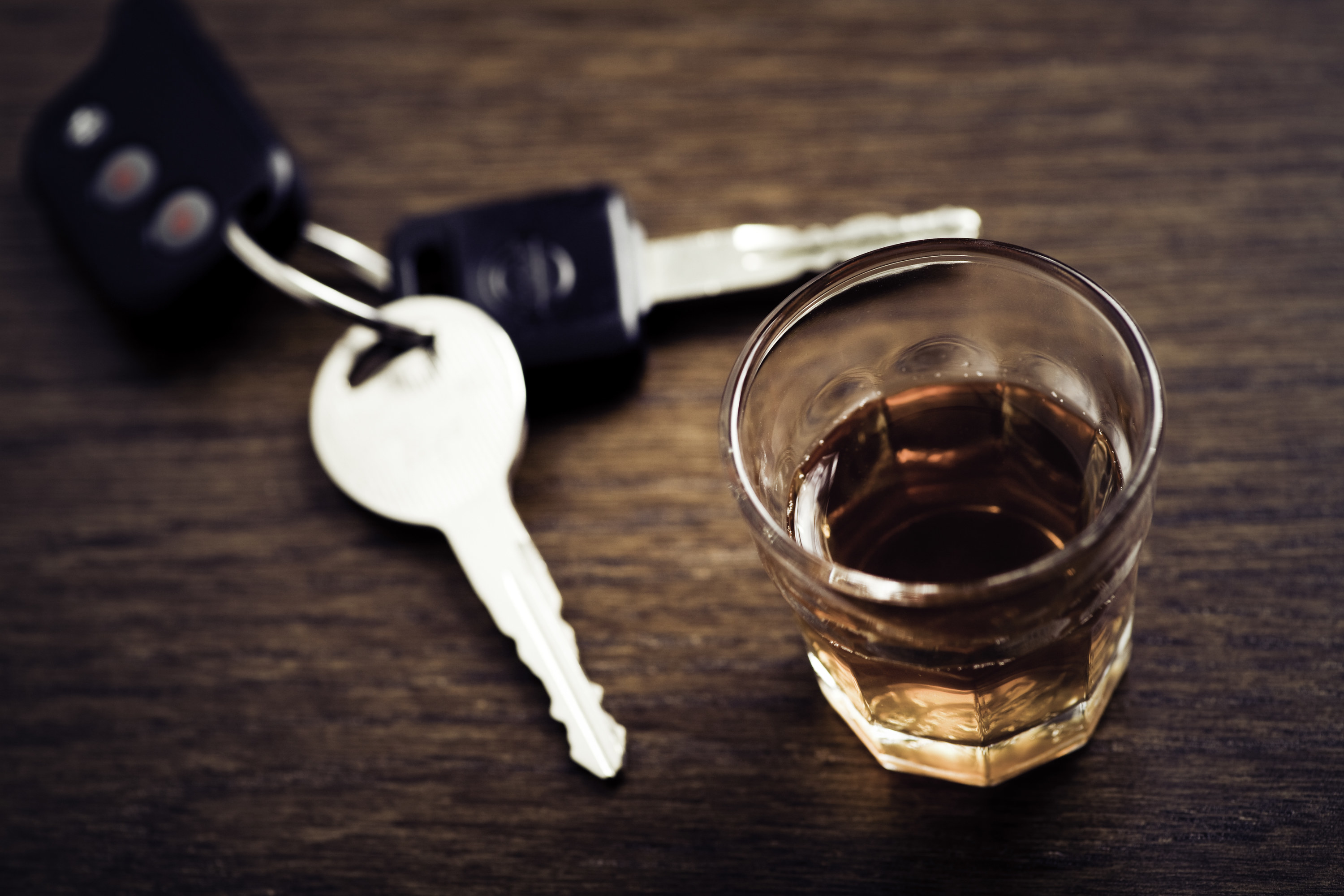 shot glass next to car keys