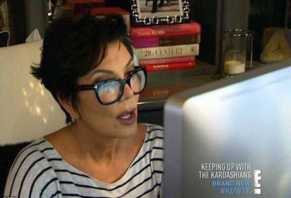 Meme of Kris Jenner reading something on her computer with her mouth open in awe