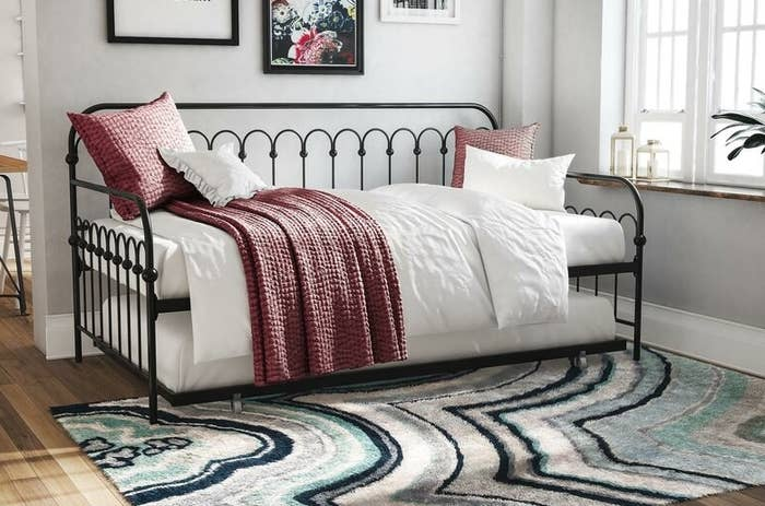 Black decorative metal daybed frame with trundle