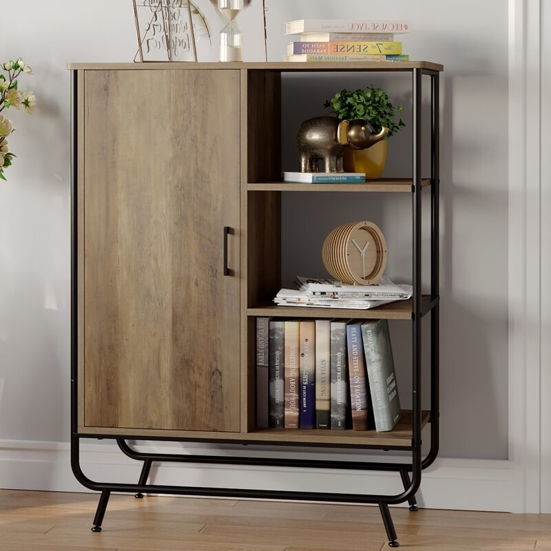 DIvided storage cabinet with black frame and wooden shelves