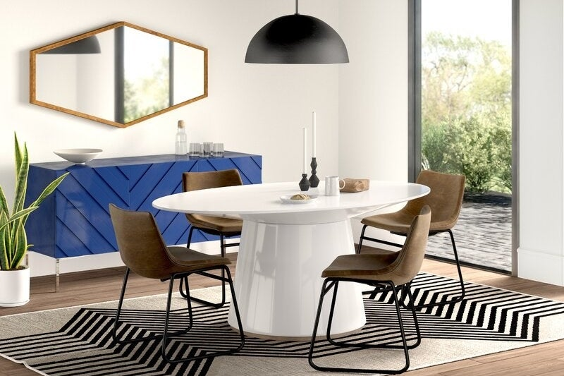 White glossy pedestal table with oval surface
