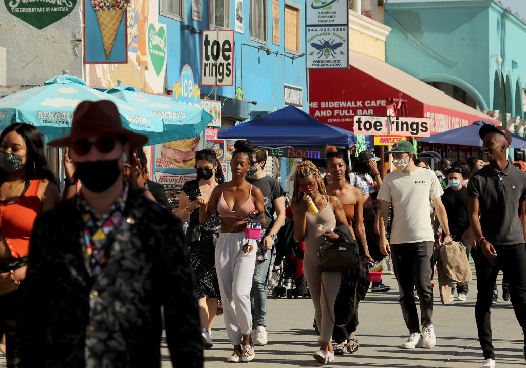 People walking without masks in Venice Beach