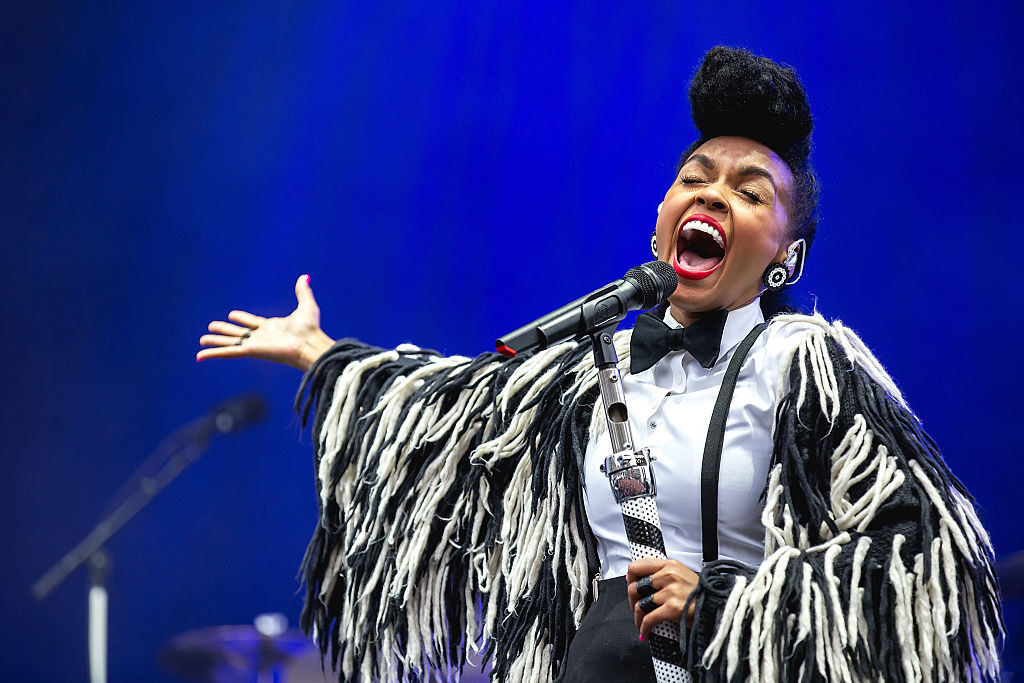 Janelle Monae sings in black and white outfit