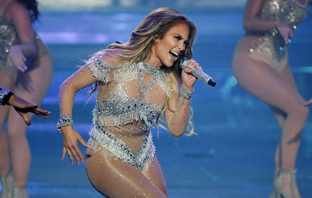Jennifer Lopez sings into microphone