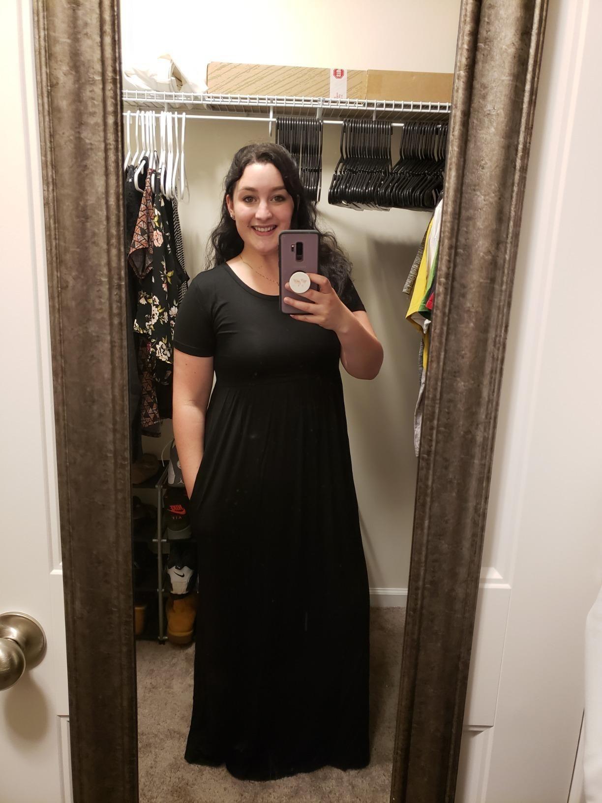 Reviewer wearing black short-sleeve maxi dress