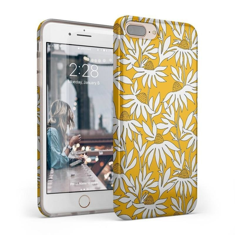 yellow phone cover with white flowers on it