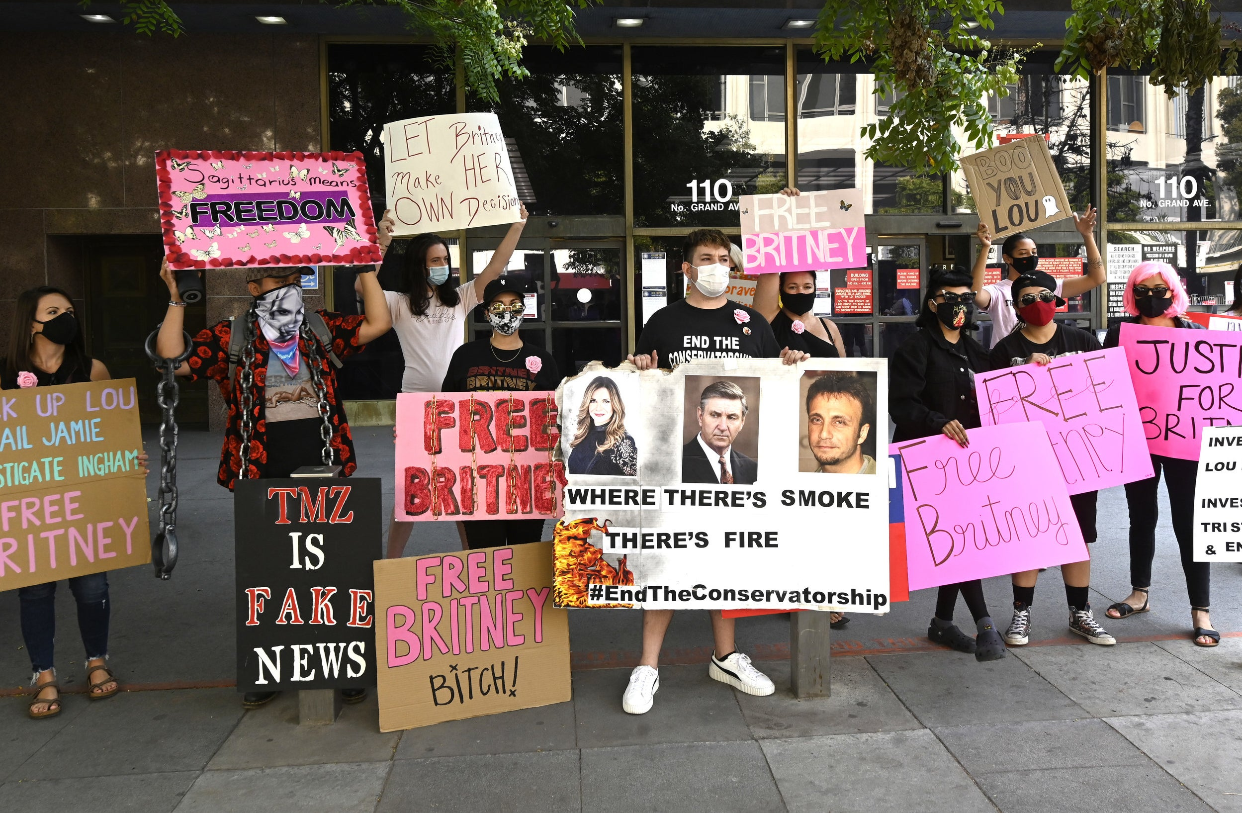 A group of Britney fans hold Free Britney signs outside of a courthouse
