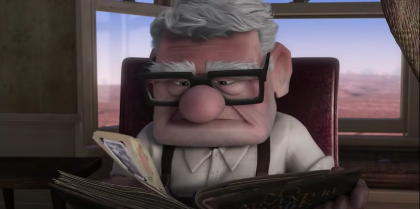 """Carl from """"Up"""" looking in an old photo album"""