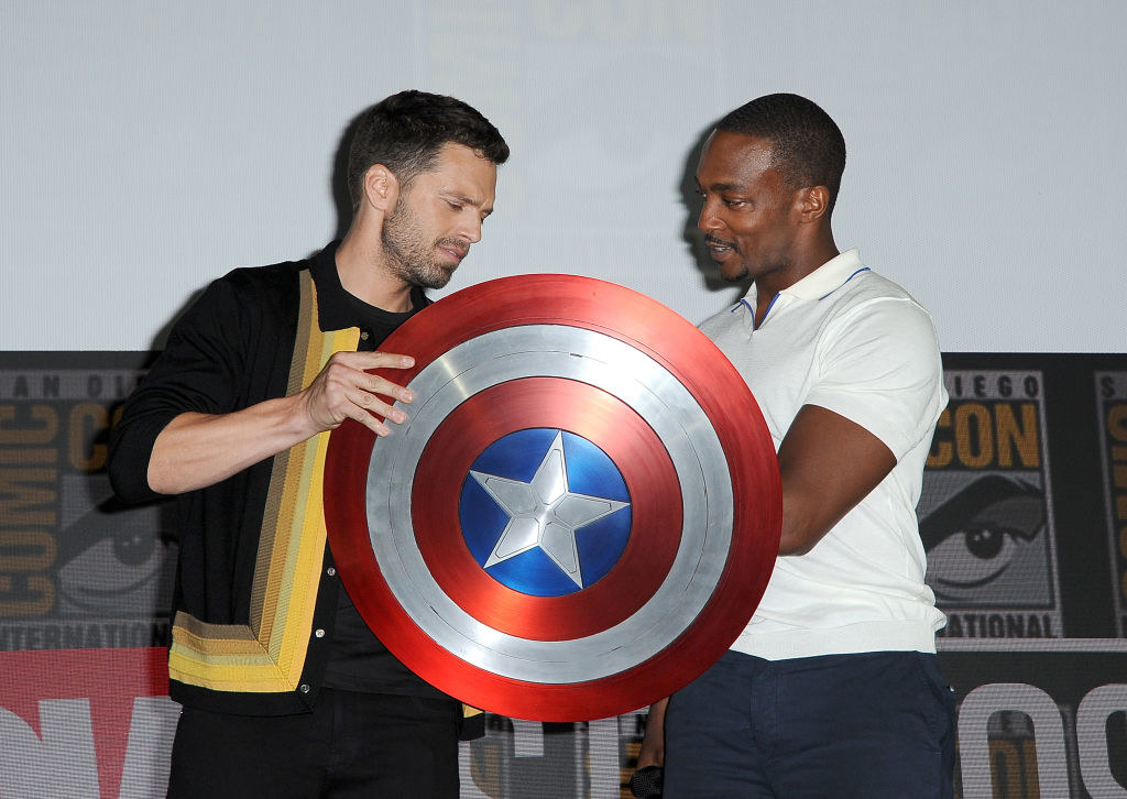 Sebastian and Anthony holding Captain America's shield together