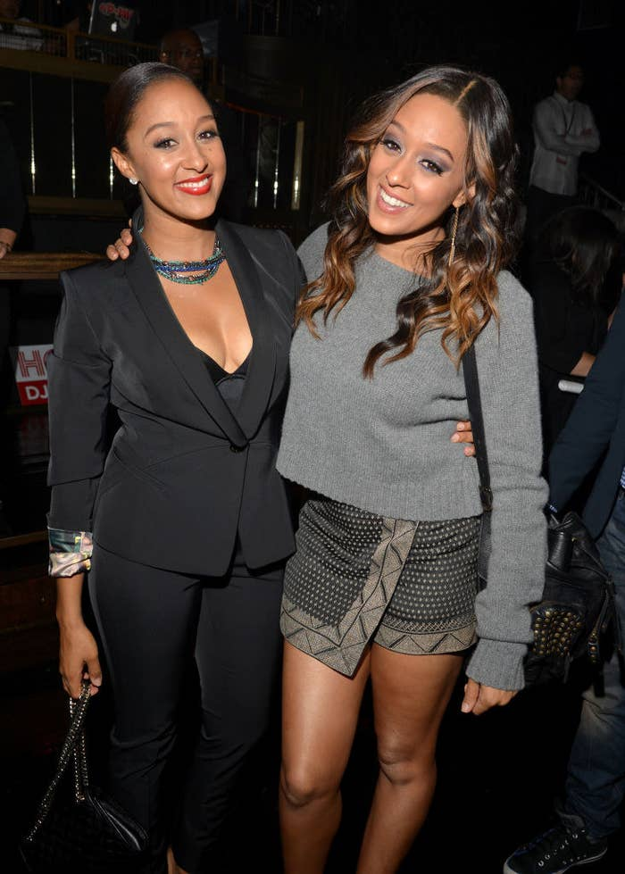 Tamera Mowry-Housley and Tia Mowry-Hardrict smiling at the TV Guide Magazine's Hot List Party