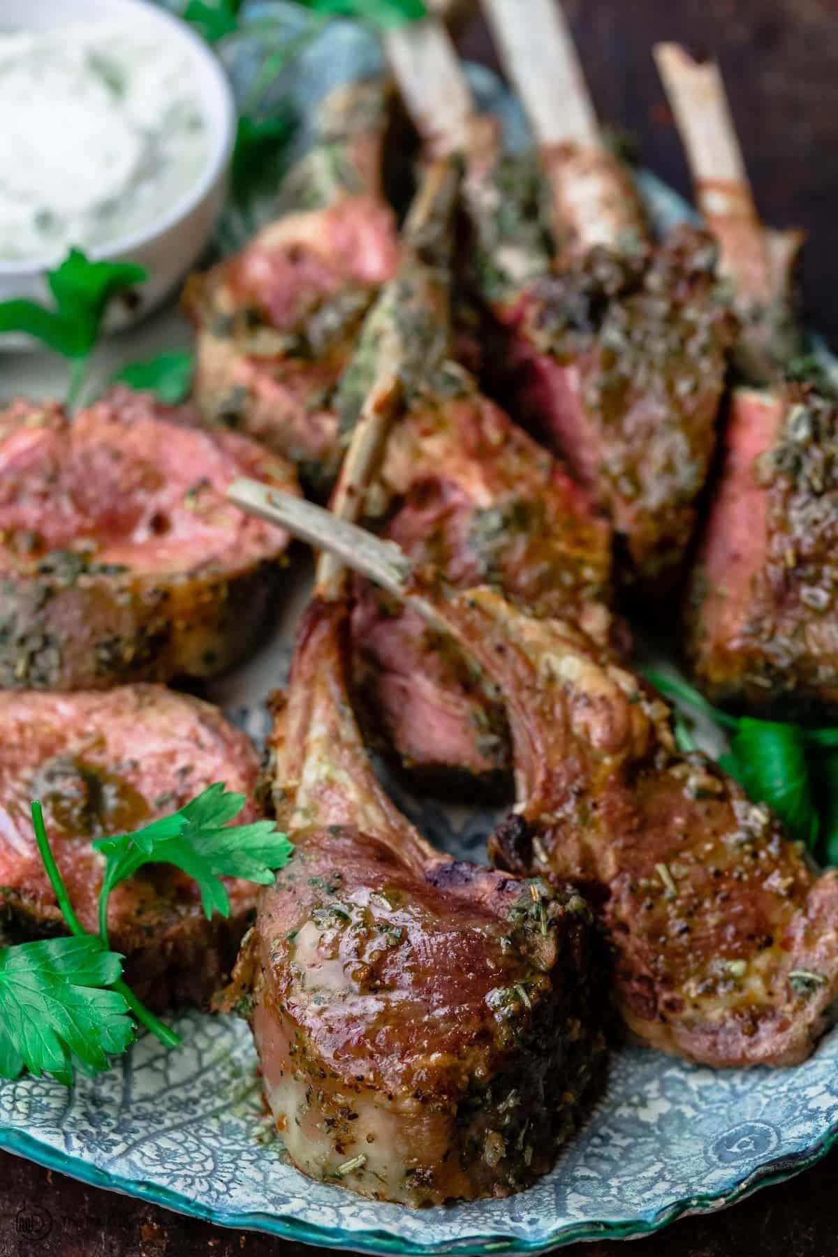 Roasted lamb chops on a serving platter.