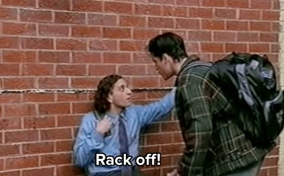 Con tells Nick to rack off in front of a brick wall