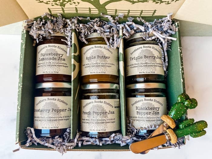 Six uniquely flavored jams inside glass jars and decorative packaging.