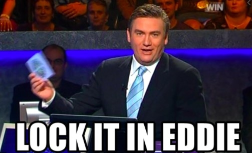 """Eddie McGuire sits on the """"Who Wants to be a Millionaire?"""" set with the caption """"lock it in Eddie"""""""