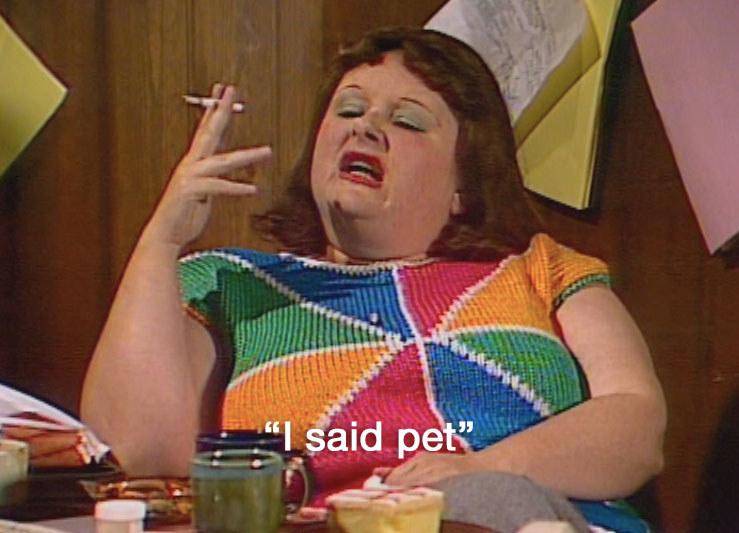 "Lynne smokes a cigarette and says ""I said pet"""
