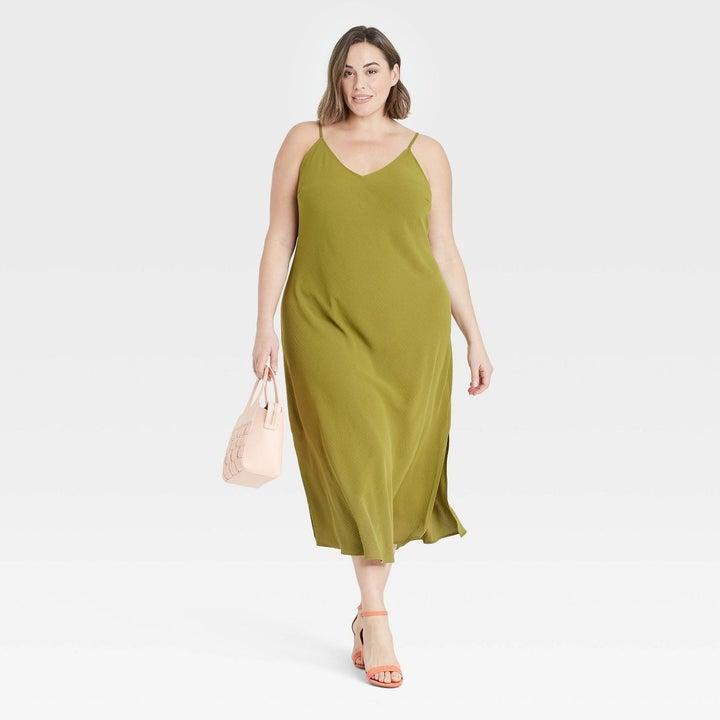 Model in green slip dress