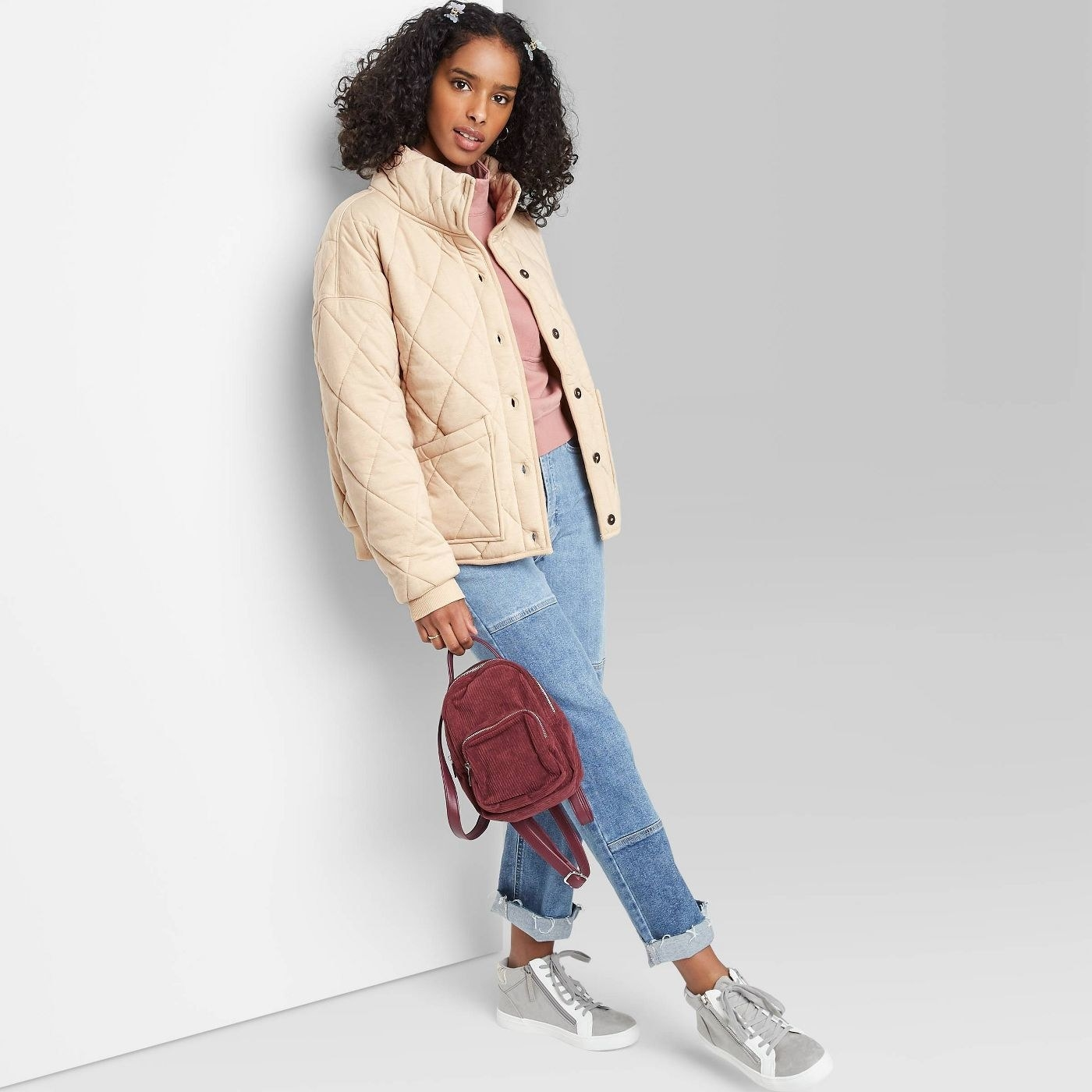 Model in button front quilted jacket