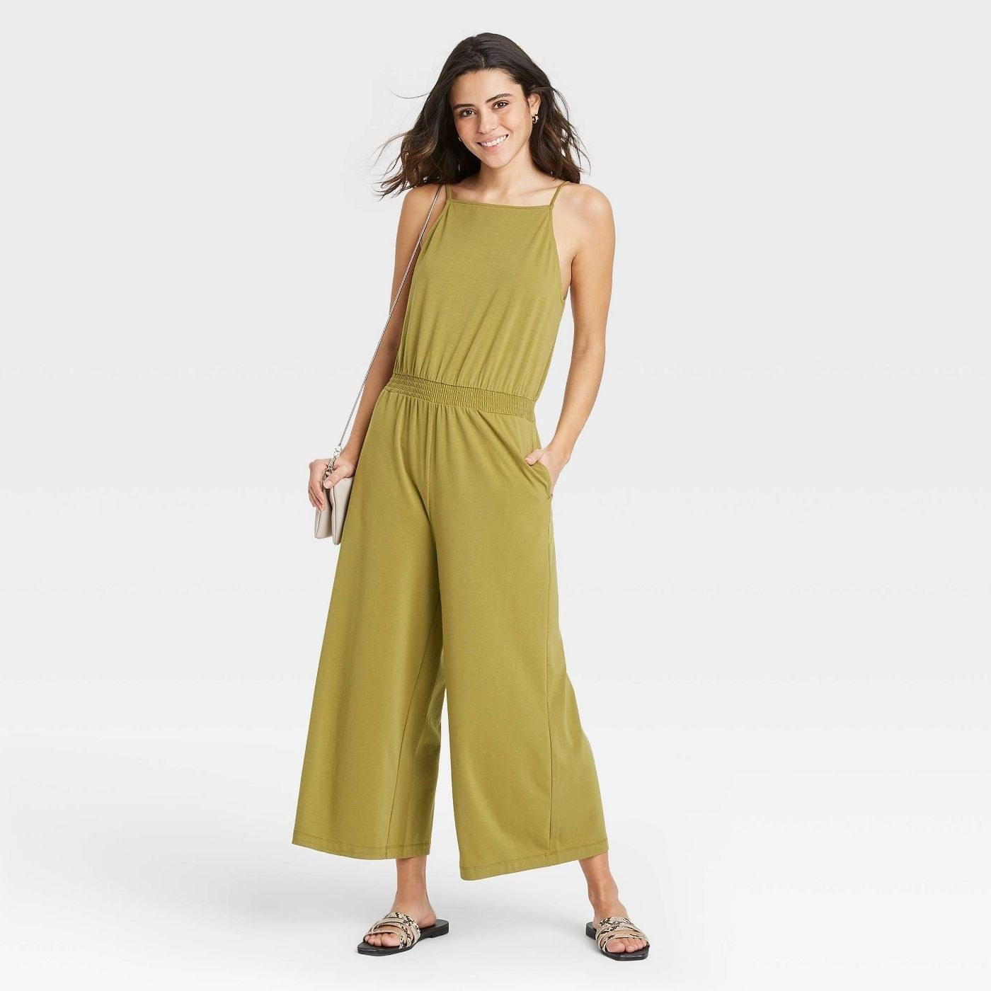 Model in sleeveless smocked jumpsuit