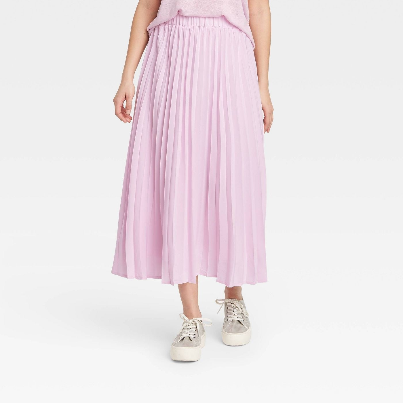 Model in midi pleated a-line skirt