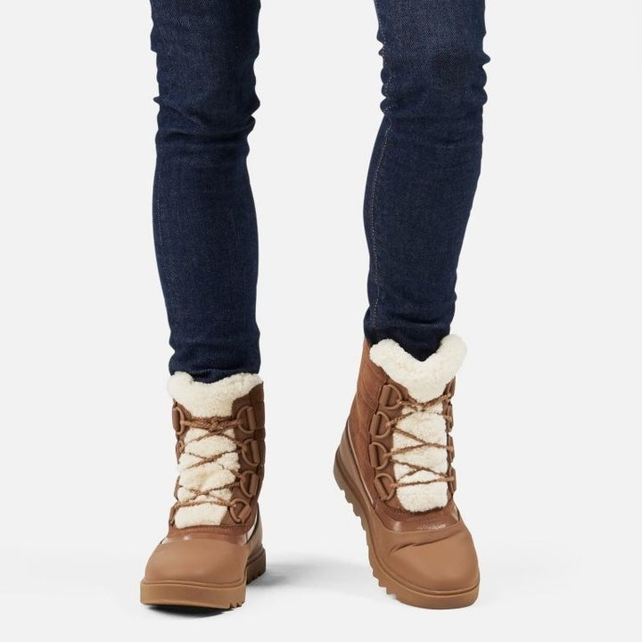 model wearing the tan winter boots
