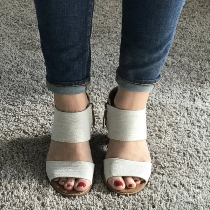 reviewer wearing the cutout sandals