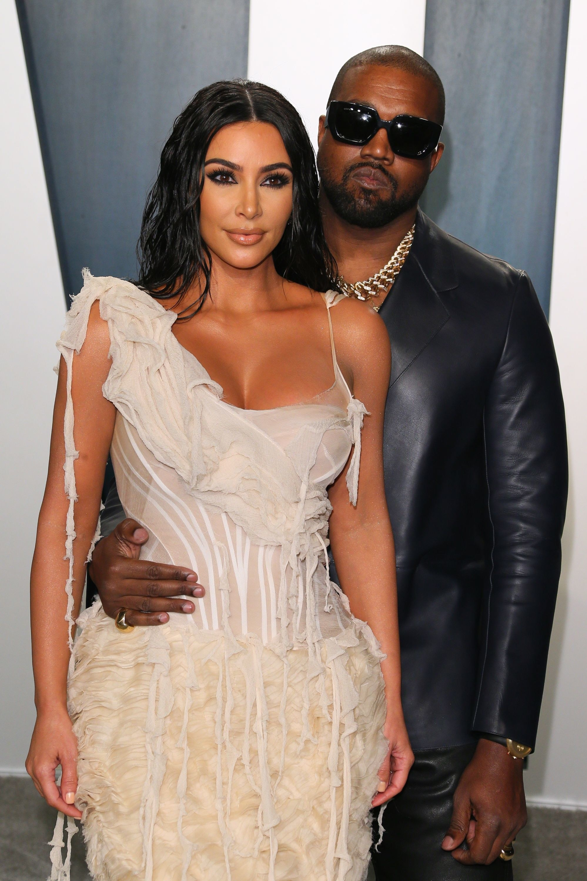 Kim and Kanye posing at a press event