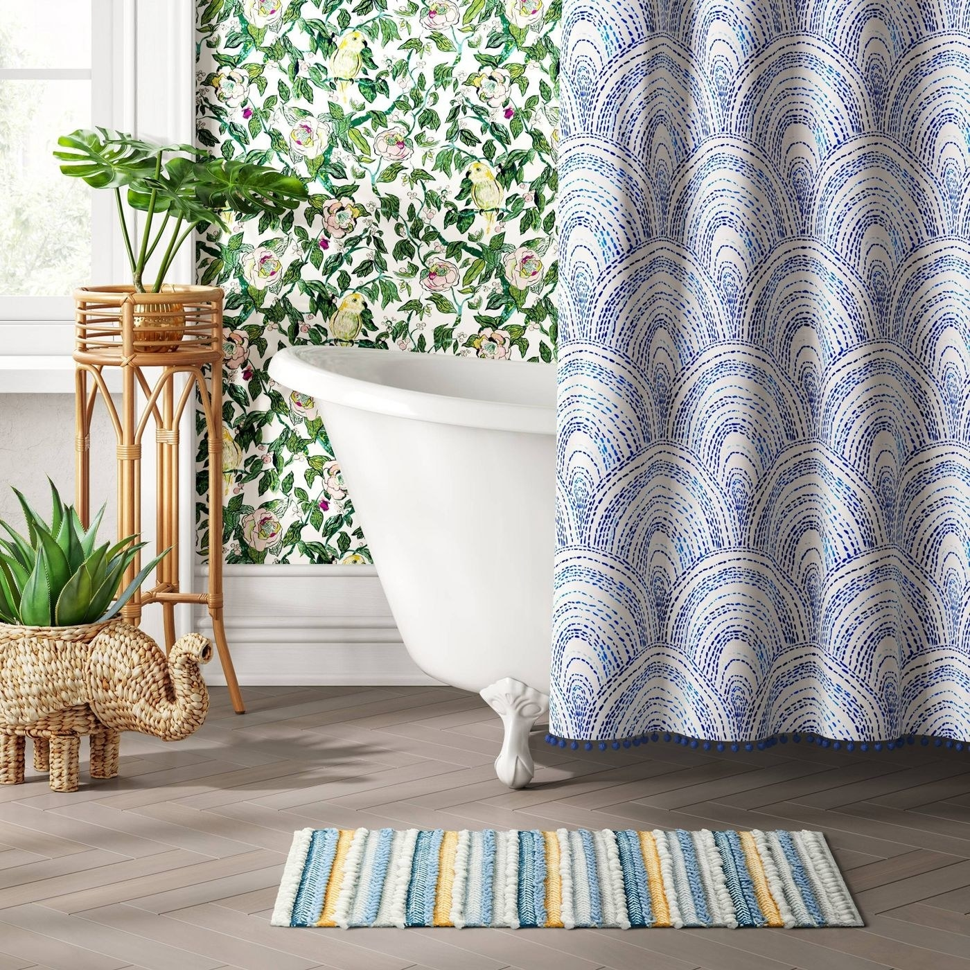 blue, white, and yellow rug next to a tub
