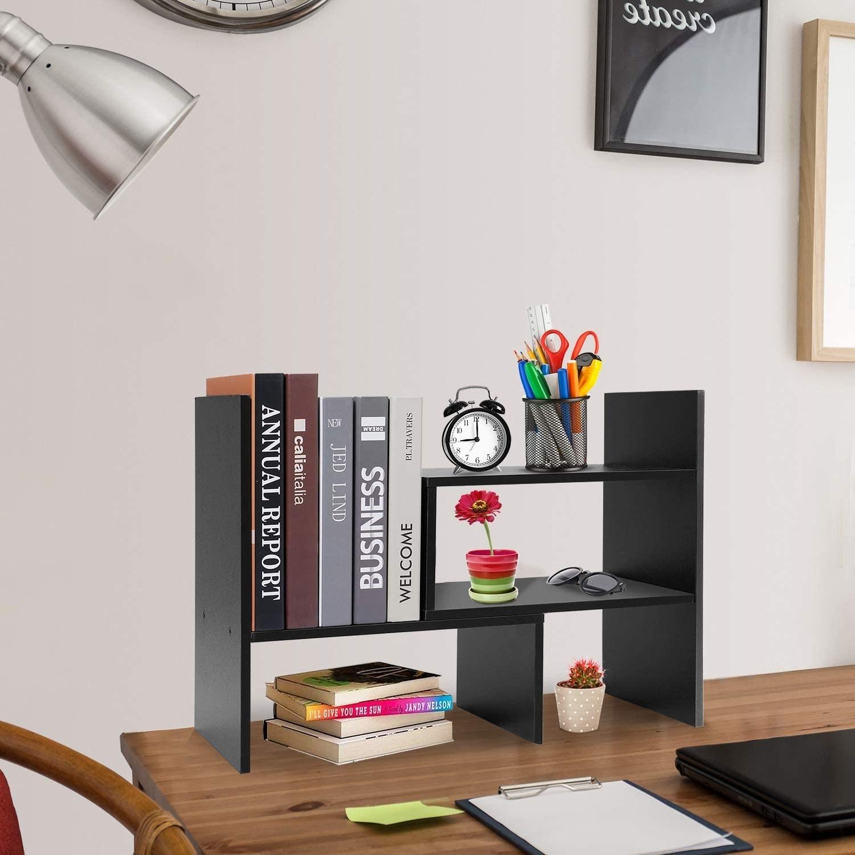 Desktop shelving unit placed on desk
