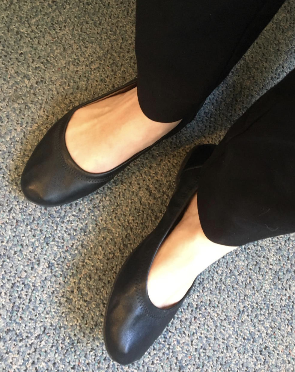 reviewer wearing the black flats