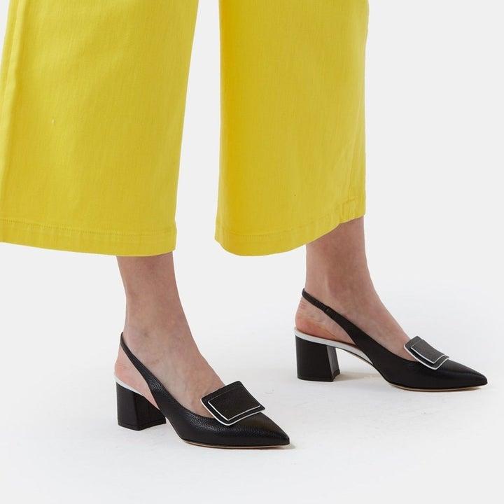 model wearing the black slingback heels