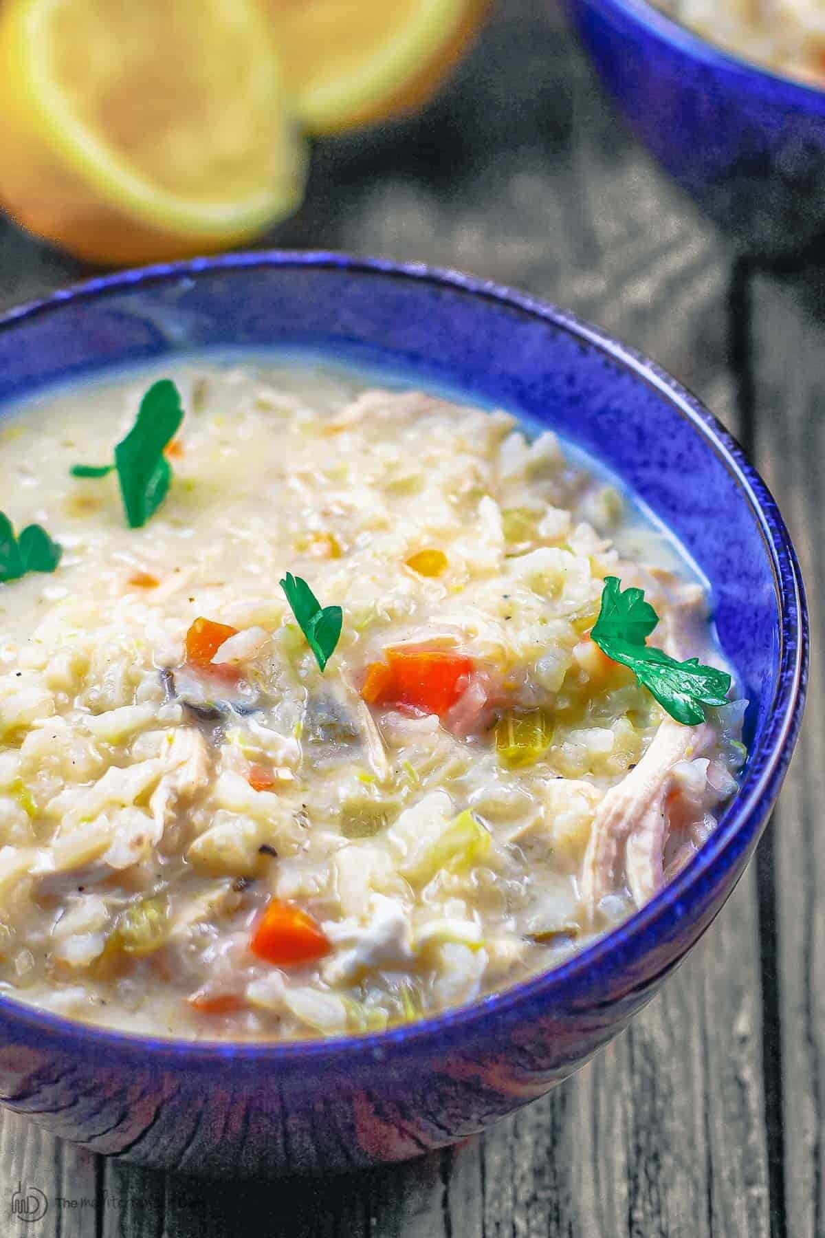 A bowl of Greek chicken and rice soup.
