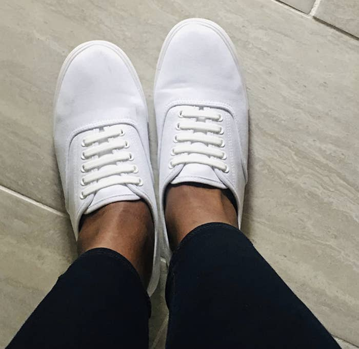 reviewer wearing white lace-up sneakers
