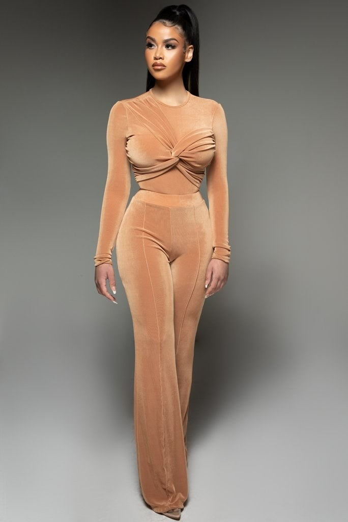 Model wearing nude-colored floor length pants