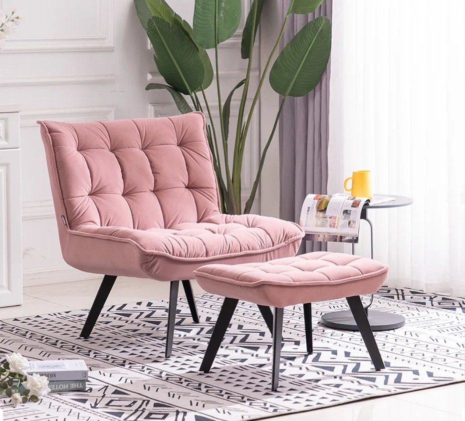 Pink velvet chair with black legs and matching pink ottoman