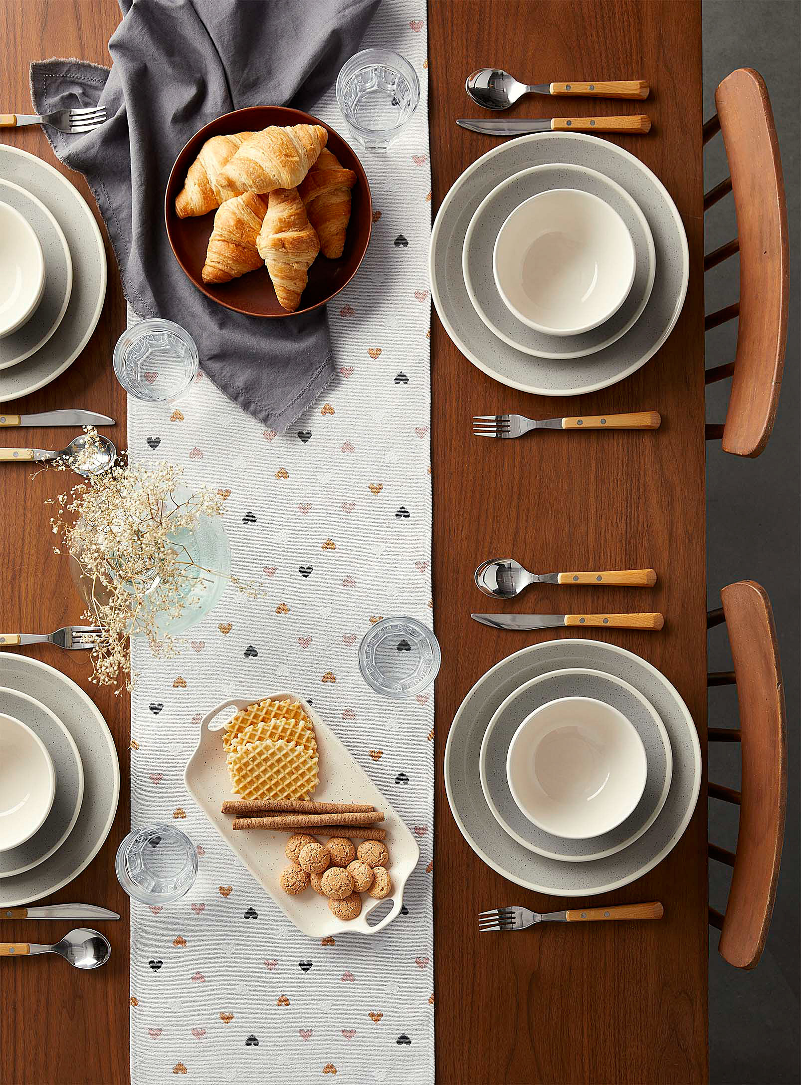 the table runner on a set table with a bowl of croissants and honeycomb and biscuits