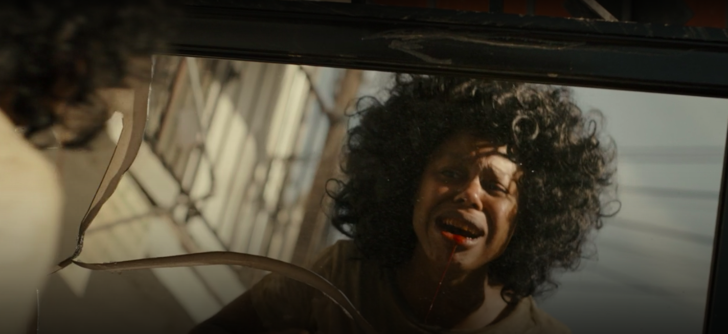 "Wanda's mouth is bleeding in a scene from ""Snowfall"""