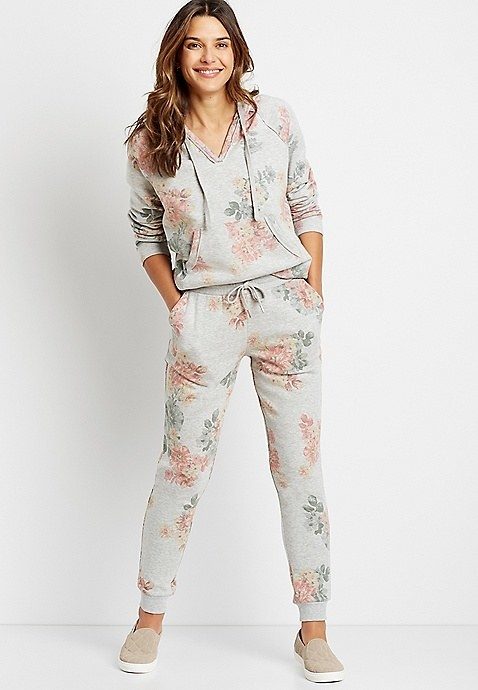 Model wearing grey floral jogging bottoms
