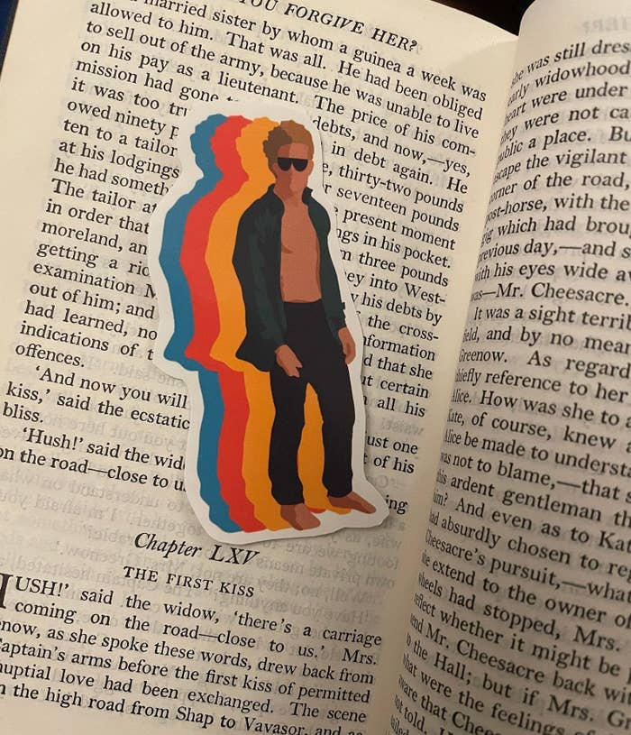 The Luis Miguel sticker placed in a book