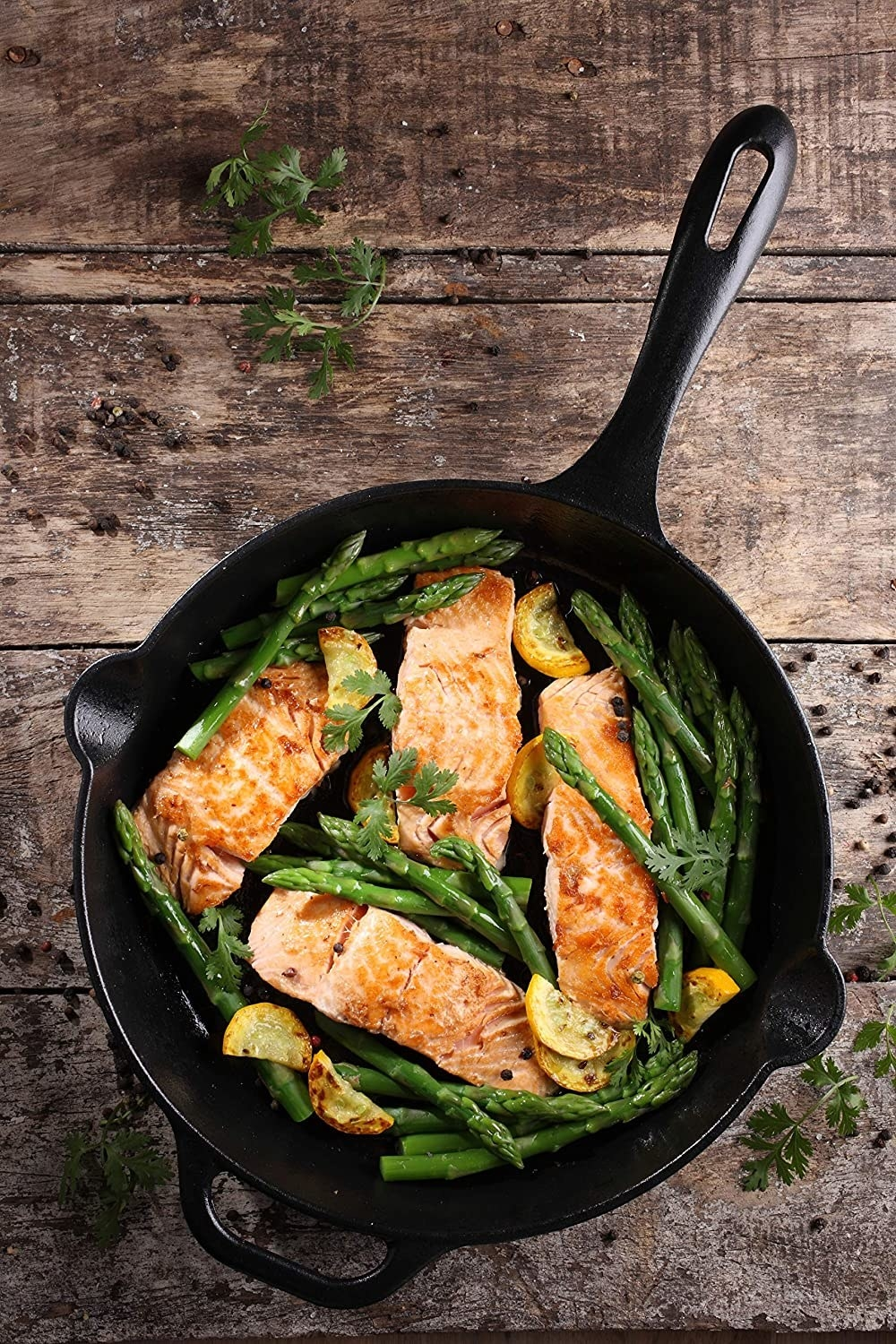 Salmon and asparagus in the skillet with our spouts and a helper handle