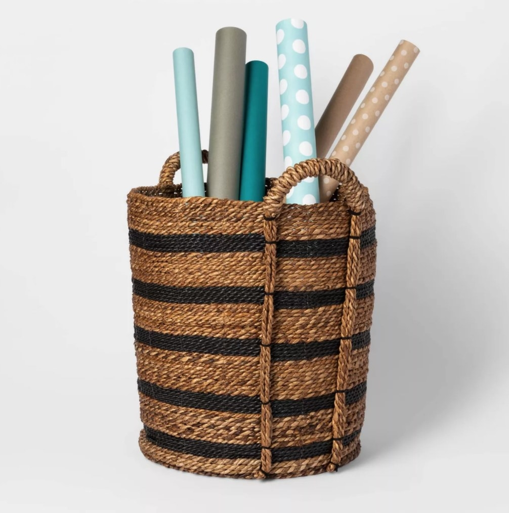 the brown and black cylindrical basket with handles