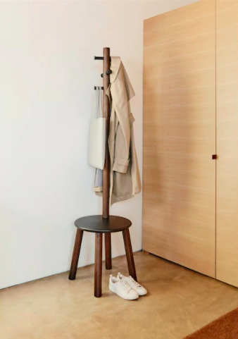 A coat rack with a built-in stool