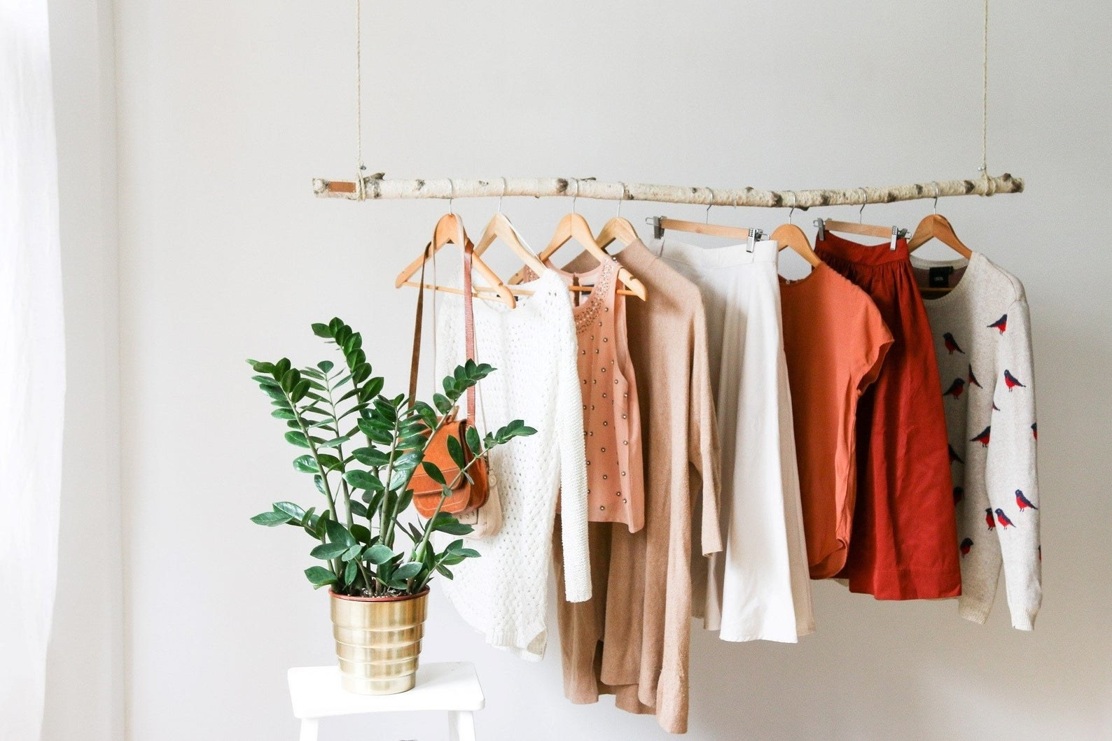 Clothes hanging from the birch branch clothing rack