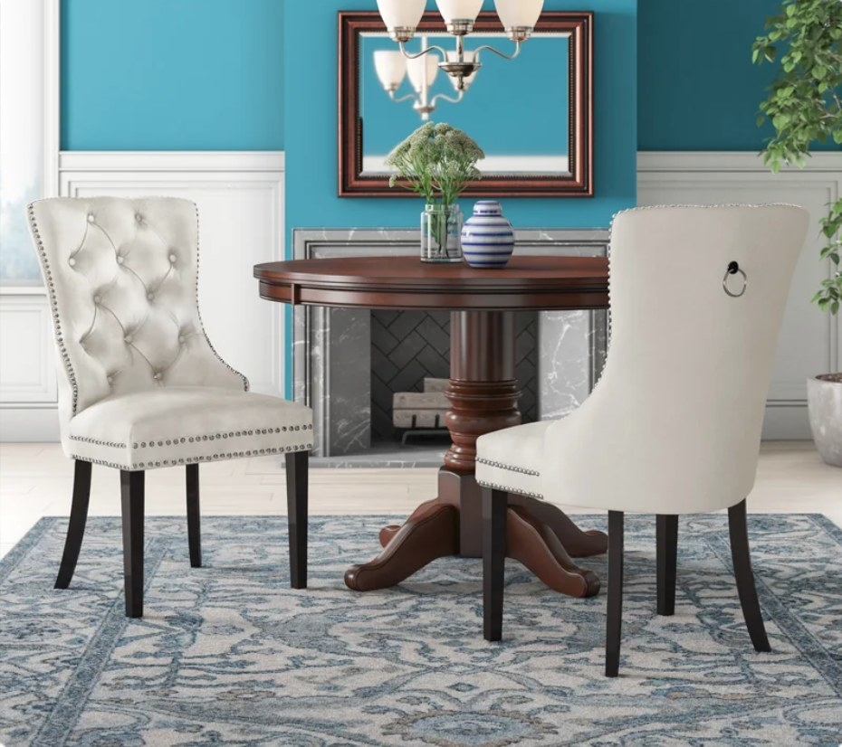 White velvet, upholstered kitchen chairs with nailhead studding