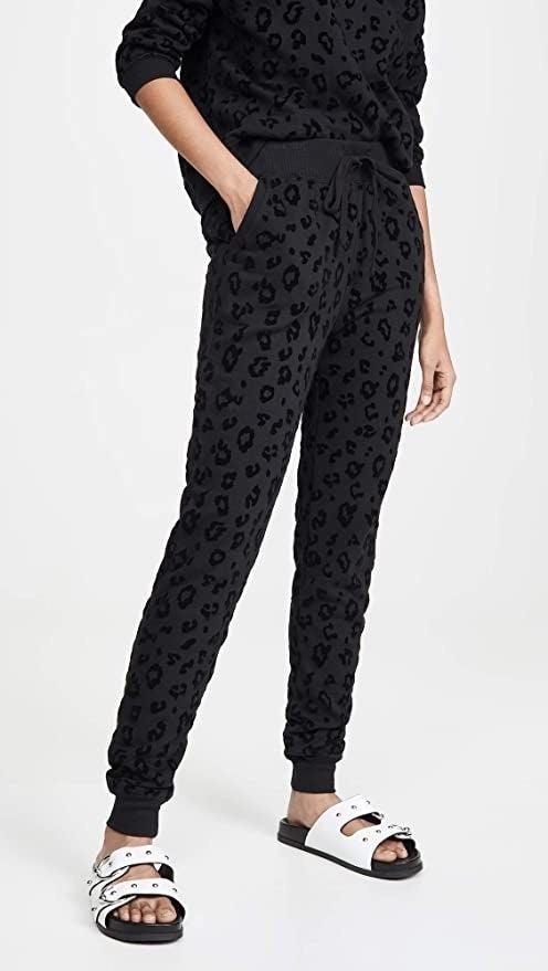 Model wearing a gray and black animal print jogger pants