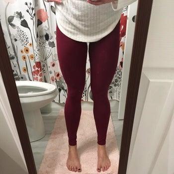 Reviewer wearing burgundy pair